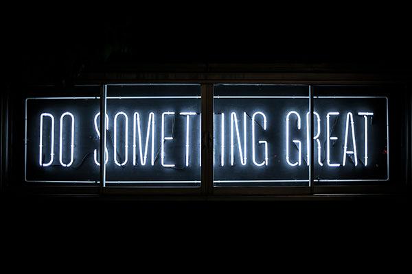 Neon light reading Do Something Great